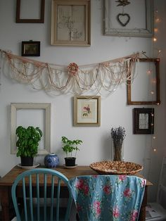 Lovely! Shabby chic.  Like the  framed heart hanging from vintage card bird.  Like the plant in front of empty frame.