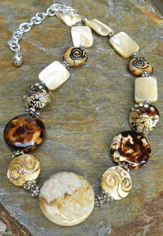 Fossil Coral focal with artisan crafted lampwork beads,Leopardskin Fire Agate,Natural Mother of Pearl and Bali sterling silver