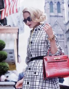 Grace Kelly. LOVE the black & white trench with the red Hermes bag that was named in her honor....