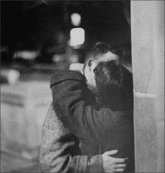 Young Couple kissing on the terrace just before curfew, 1957Grey Villet