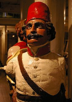 Cutty Sark, the preserved tea clipper at Greenwich, houses a collection of ships' figureheads from the 19th century.  This one is 'Gordon of Khartoum'.