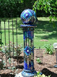 Garden Globe made from old CDs and a Styrofoam ball plus some