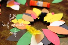 Fall Leaf Wreath Paper Plate Craft   - fun and uber-easy craft to do with preschool kids to celebrate fall