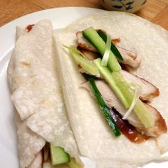 Chicken and Hoi Sin Chinese Pancakes omg these are so yummy too follow the link and follow the recipe you can make roast pork and do that too had it a few times at chinese restraunts they so delicious :)