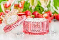 Sterling Candle - Strawberries & Champagne. A toast to surprises! Celebrate life's precious moments with this dreamy blend of red berries, rose and orange flowers. Cheers!