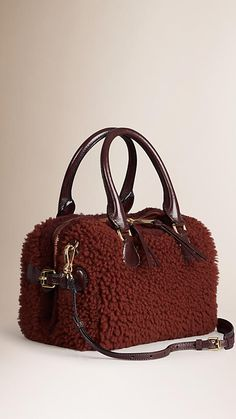 Burberry Redwood The Mini Bee in Shearling - A mini bowling bag in tactile shearling and smooth leather. The bag features a contrasting shearling trim and a grosgrain interior with concealed wing pockets lined in soft leather.
