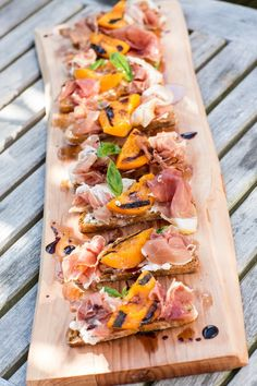 Apricot Crostini with Goat Cheese, Prosciutto- perfect small bite when entertaining at home. Sweet grilled apricots, soft goat cheese & salty prosciutto.