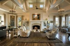 Stunning coastal style great room design with exposed beams and ship-lap paneling. via Herlong & Associates http://homechanneltv.blogspot.com/2014/05/gorgeous-great-rooms.html #greatrooms #coastalhomes #cottagehomes