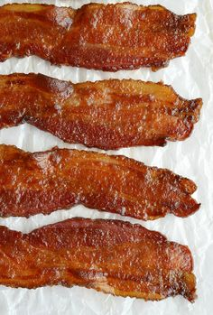 This Candied Bacon Recipe should be illegal. It IS that good! Just 3 ingredients make a glazed bacon that is sweet, salty, crispy and super addictive. This apple butter glazed bacon is perfect for any meal or occasion! ad