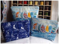 Padded nautical-themed zipped pouches