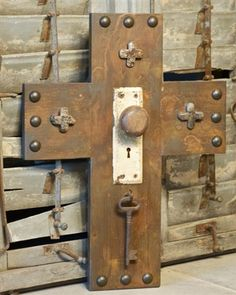 Beautiful large handmade cross decorated with nail heads, a vintage door knob, a large skeleton key from Turkey, and natural stones from Shanghai. Wooden Crosses, Crosses Decor, Wall Crosses, Diy Projects To Try, Wood Projects, Horseshoe Projects, Vintage Door Knobs, Rustic Cross, Old Rugged Cross