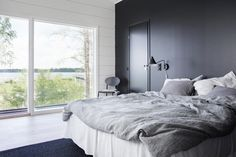 Markki - black and white master bedroom with a lake view House, Interior, Home, Home Bedroom, House Inspiration, New Homes, Log Home Interiors, Show Home, Soothing Bedroom