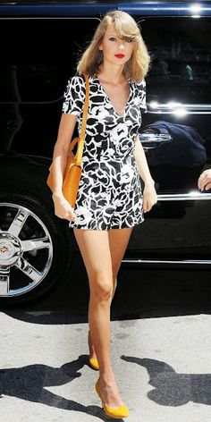 Taylor Swift in a floral romper and yellow pumps