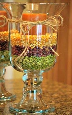 popcorn, kidney beans and split peas as a candle holder