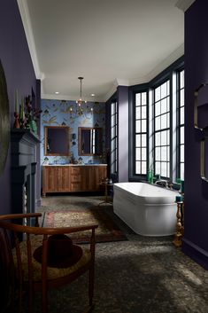 Classic Victorian architecture showcased with dramatic, cool colors. Explore this statement making master bath.