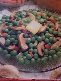 10oz frozen peas 1 cup sliced mushrooms 1/4cup chopped onion 2T butter 1t sugar 1T chopped pimiento  Cook/steam peas, sautee mushrooms and onions in butter, add sugar, 1/2t salt and dash pepper, add peas and pimiento. Cover. Heat through. From Better Homes and Garden Cookbook, from 1970s-80s?