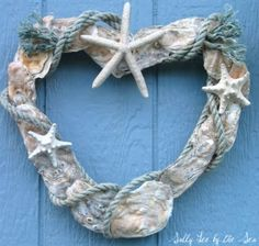 Heart wreath made with oyster wheels and other shells on top.