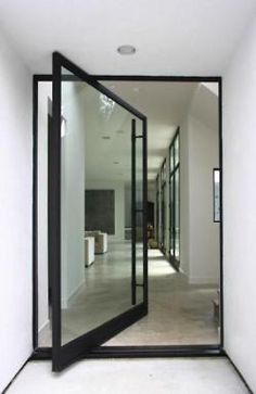 Swivel pin glass Door for extra large entrance.   Favorite doors of www.andrearodman.com  A Vancouver based Interior Design Firm.