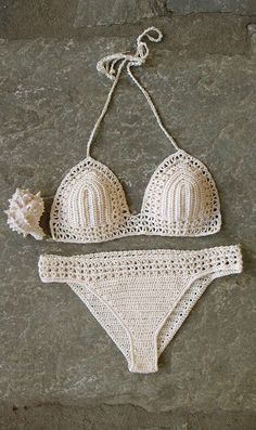 Set of boho crochet bikini and bottom in cream. Retro, boho chic style. The lace crochet stitch makes this bathing suit tender as a sea foam. Every woman in this swimsuit will be favorite on the beach or at the pool. The bra cups are well shaped and adjustable due to the cords to bind, so you