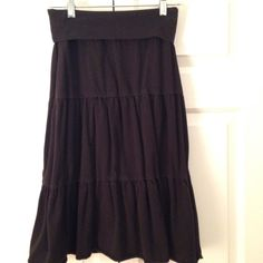 Ann Taylor Loft Black Skirt SZ XSP Adorable Ann Taylor Loft black skirt. Fold-over waistband and seaming to create multiple tiers. Good condition. 95% cotton, 5% spandex. Machine washable. Ann Taylor Skirts Midi