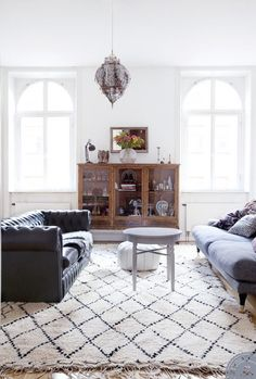 love the two different styles of sofas and the coffee table alternatives