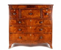 American, 19th century. American mahogany chest of drawers with rectangular top over a frieze mounted with 3 cross-banded panels, the central one concealing a hidden drawer over three deep drawers decorated with stylized stringing above three long, graduated drawers, each drawer with yellow pine secondary, individual locking mechanisms, large wood turned decorative pulls, beaded and inset with ivory escutcheons, separated by dust boards and raised on front French feet united by a shaped…