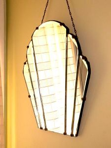 I love the style of the chain hanger on this art deco mirror.