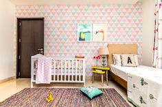 Loving this shared nursery. And, that triangle wallpaper is so sweet!