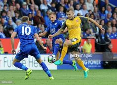 News Photo : Jack Wilshere of Arsenal takes on Marc Albrighton...