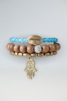 These irresistibly elegant charm bracelets are the newest take on our popular Charm Bracelets. Sold in a set of three and perfect to mix-and-match with other Me to We Artisans pieces, each bracelet is arranged on a high-quality band with enough stretch to fit and any wrist. One bracelet in this stunning set features pressed Czech glass beads, accented with a brass-cast Sikirar shell, crafted using shells sourced near a community where our charity partner Free The Children works. The second…