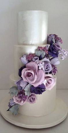 Purple and pink floral wedding cake