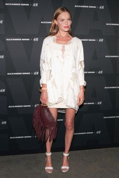 Kate Bosworth wears a white crochet mesh detail dress, strappy heels, and a fringed clutch