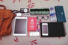 What's in my bag: - Camera. - Pencil bag. - Water (very important). - Wallet. - iPad. - iPad/iPhone charger. - Journal. - Pills. - Lip balm....