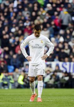 Real Madrid's Portuguese forward Cristiano Ronaldo looks downwards during the Spanish league football match Real Madrid CF vs Club Atletico de Madrid at the Santiago Bernabeu stadium in Madrid on February 27, 2016.