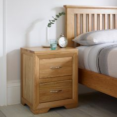 The Bevel Natural Solid Oak Two-Drawer Nightstand is designed to be the ideal companion for the Bevel Solid Oak Bed, but its contemporary design allows it to complement almost any of our natural oak beds. Featuring two generously-sized brushed-metal-handl Oak Bedroom Furniture, Oak Furniture Land, Room Furniture Design, Furniture Projects, Furniture Online, Furniture Plans, Oak Nightstand, Bedside Tables, Oak Bedside Cabinets