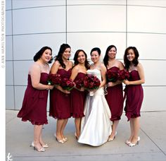 The dark-red, knee-length dress that each of the bridesmaids wore had a sweetheart neckline, a shirred bodice and a ruffled hem. Pearl necklaces and bracelets paired well with the elegant dresses. Dark Red Bridesmaid Dresses, Red Bridesmaids, Wedding Dresses, Garnet Wedding, Maroon Wedding, Exotic Wedding, Wedding Styles, Wedding Ideas, Wedding Stuff