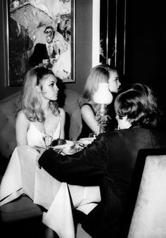 Sharon Tate, Barbara Bouchet, and Roman Polanski at the Playboy Club in London