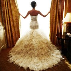 Holy #FEATHERS  what a #dress!  I may have to get married!