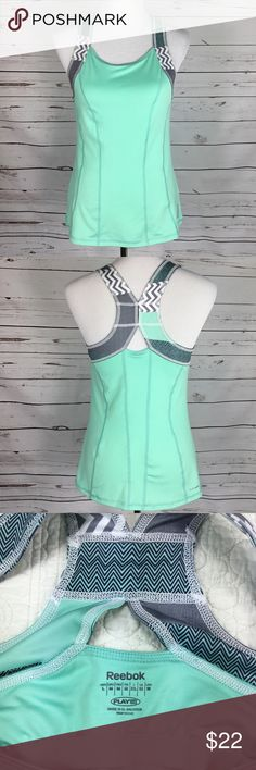 Reebok PlayDry Sports Tank. Size M. Cute Reebok Play Dry Sports Tank W/Built in Bra.  2 Small spots on front, size of pencil dot. Size Medium. Please See All Pictures For Approximate Measurements. Thank you for shopping my closet.☀️ Reebok Tops Tank Tops
