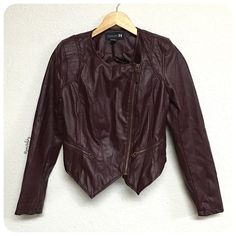 "F21 moto jacket PRELOVED in great condition, faux leather moto jacket. shoulder pads, zippered wrists, and high back. purple/maroon in color  details ∙ small ∙ 16"" bust ∙ 21"" length front to point, 16.5"" back  ∙ 23.5"" sleeve  materials ∙ 100% polyurethane ∙ 100% polyester shell  due to lighting- color of actual item may vary from photos  please don't hesitate to ask questions. happy POSHing     price firm unless bundled  i do not trade or take any transactions off poshmark Forever 21 Jackets…"