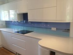 Digitally printed glass splashbacks, installed in East Budleigh. The image runs through 3 separate pieces of glass.