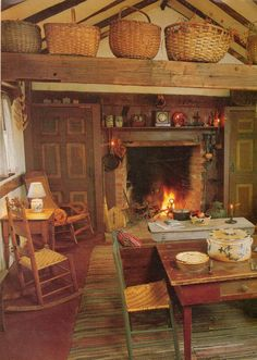 Primitive Country kitchen complete with straw baskets and a toasty fire in the hearth.