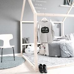 Use cot mattress as low, comfy seating, with funky fitted sheet and loads of pillows and cushions and possibly frame/teepee over it - lots more colour than this image though!