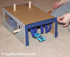 Turn a cardboard box into a car wash for Hot Wheels cars - perfect rainy day project!