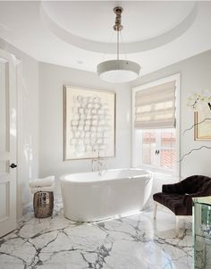 Beautiful simple design - like the simplicity of the crisp marble floors. Think it's totally doable for small bathroom