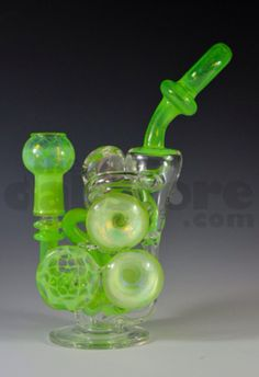 http://www.thedabstore.com/collections/rigs/products/anodyne-glass-slime-honey-overload-mini-recycler-14-mm  Anodyne Glass recyclers are some of the cleanest and best functioning recyclers that we carry. Anodyne has been blowing glass for years;  he started off as a scientific glassblower, where he honed his skills for almost 20 years before migrating over to the dabbing market.  This piece features an inline perc going up into a recycler function.  The Coriolis effect on this piece is…