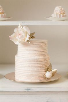 Simple, white cake (via Wedding Riot).