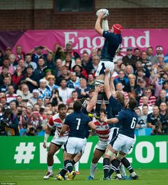 Grant Gilchrist is raised high by his Scotland team-mates as he grabs hold of the ball during an unconstest lineout. RWC 2015