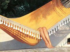 Brigitte Bardot. Idling in a hammock. In St. Tropez.