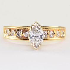 Estate 0.44 Carat VVS2 marquise diamond ring. This 14 karat yellow gold ring has one center marquise cut diamond at 0.44 carats VVs2 clarity G color and